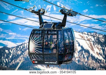 Demanovska Dolina, Slovakia - February 18: Skiers In Modern Cableway Funitel In Ski Resort Jasna - L
