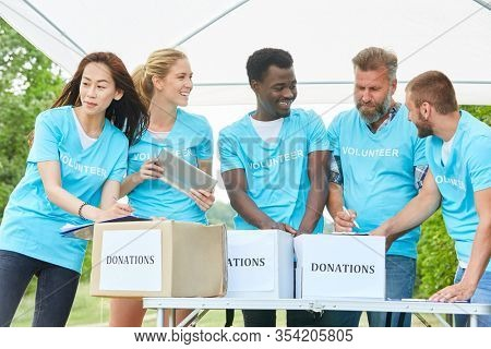 Group of volunteers collecting donations for a non-profit organization