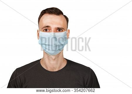 Unhappy, Sad Young Man Wearing A Protective Face Mask Prevent Virus Infection Or Pollution On White