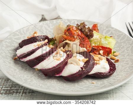 Baked Beetroot With Cheese And Cashews. The Concept Of Healthy Eating