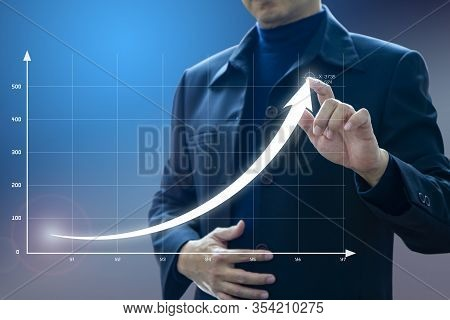 Businessman Drawing An Exponential Curve Of A Progress In Business Growth Performance, Return On Inv