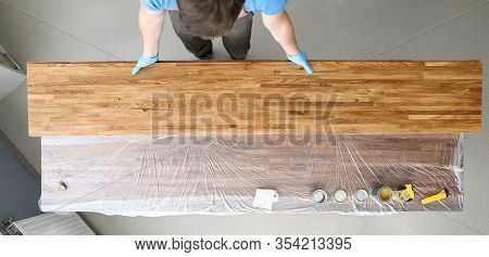 Woodworker Varnishes Wood Sheets, Beautiful Color. Protection Against Moisture, Insects And Aggressi