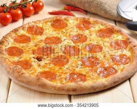 Classic Pepperoni Pizza On A Wooden Table