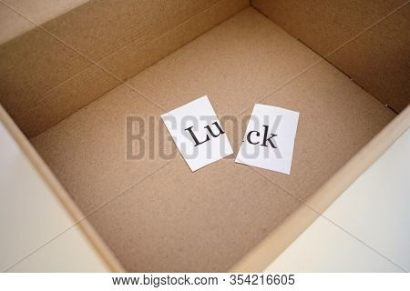 In The Box Is A Piece Of Paper With The Inscription Luck It Is Cut In Half. A Package Came With Brok