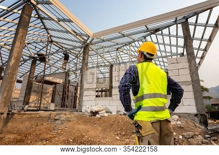Construction Engineer Worker,civil Engineer Checking Work At The Construction Site, House Constructi