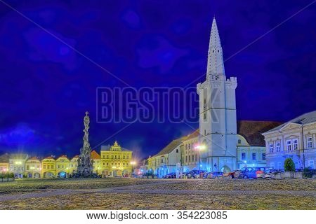 Kadan, Czech Republic - March 02, 2020: Empty Nighty  Mirove Namesti Square With Tower And Column