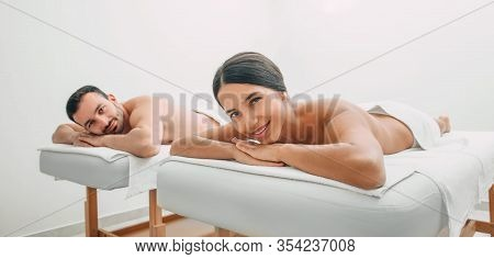 Mixed Race Woman Smiling Looking At The Camera While Relaxing With Her Boyfriend In A Spa Salon. Cou