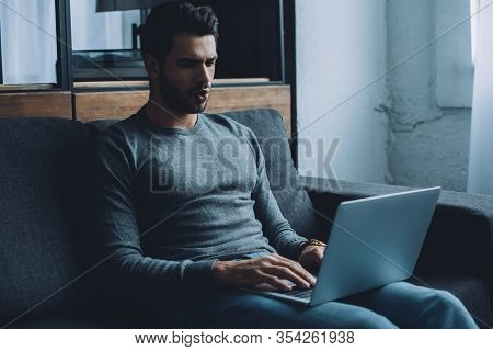 Existed Young Man Watching Pornography On Laptop On Couch At Home