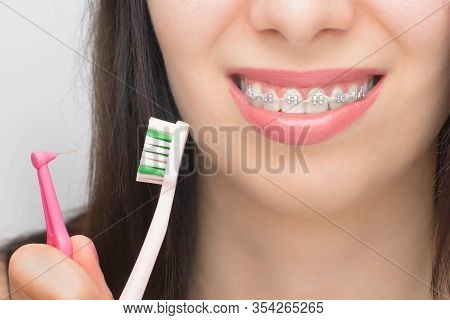Two Types Of Brush For Cleaning Teeth With Dental Braces. Brackets On The Teeth After Whitening. Sel