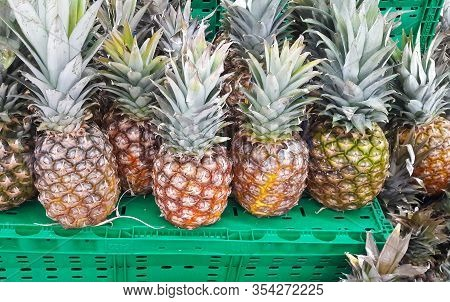 Fresh Fruits. Healthy Food. Mixed Fruit, Pineapples. Studio Photography Of Various Fruits On An Old