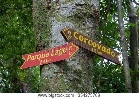 Signs On Transcarioca Trail, On Rio De Janeiro, Indicating Locations For Corcovado And Parque Lage