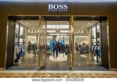 SINGAPORE - JANUARY 20, 2020: entrance to Hugo Boss store in the Shoppes at Marina Bay Sands. Hugo Boss AG is a German luxury fashion house.