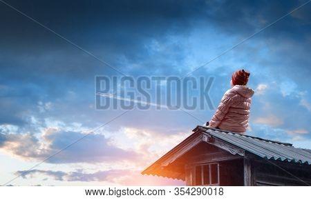 Dreamy little girl sitting alone