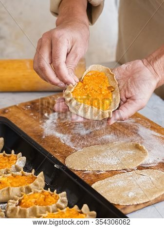 Stage Of Preparation Of Karelian Pies. Pies Are Located On A Baking Sheet, Ready For Baking. In The