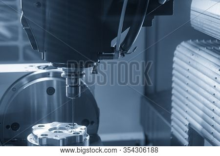 The Hi-technology Parts Machine By Cnc Milling Machine With The Drilling Tools. The Hi-technology Me