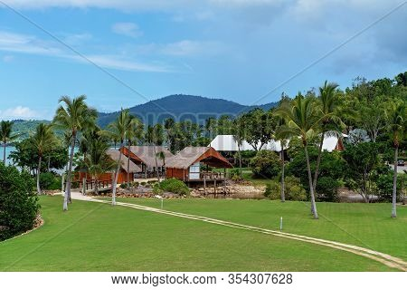 Holiday Resort Restaurant Buildings By The Beach With A Road Leading To Them Across A Small Bridge,