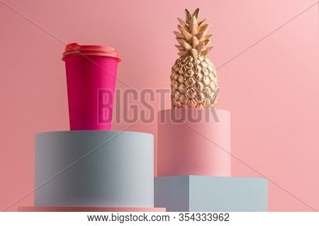 Bright Coffee Paper Cup And Golden Pineaplle On Pink Background