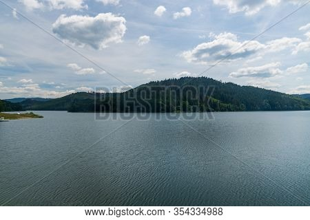 Nova Bystrica Water Reservoir With Hills On The Background In Slovakia During Nice Summer Day With B