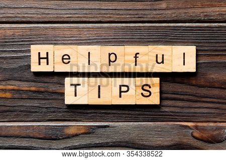 Helpful Tips Word Written On Wood Block. Helpful Tips Text On Table, Concept