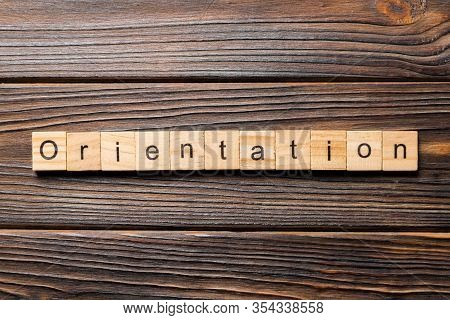 Orientation Word Written On Wood Block. Orientation Text On Wooden Table For Your Desing, Concept