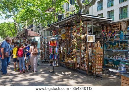 Barcelona, Spain - May 16, 2017: Selling Of The Different Souvenirs On The Famous Pedestrian Street