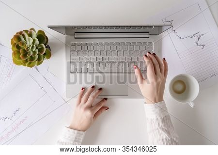 Woman Freelancer Finishing Working And Closes Laptop With Empty Drink Up Cup Of Coffee And The End O