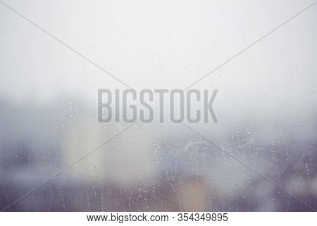 Blurrred Image Of Water Drops On Steamed Up Window