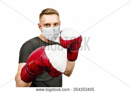 Young Man With Boxing Gloves, Wearing A Protective Face Mask Prevent Virus Infection Or Pollution On