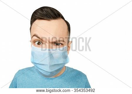 Unhappy, Sad Young Guy, Wearing A Protective Face Mask Prevent Virus Infection Or Pollution On White