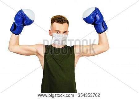 Young Guy With Boxing Gloves, Wearing A Protective Face Mask Prevent Virus Infection On White Isolat