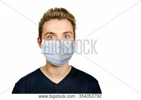 Unhappy, Sad Young Guy Wearing A Protective Face Mask Prevent Virus Infection Or Pollution On White