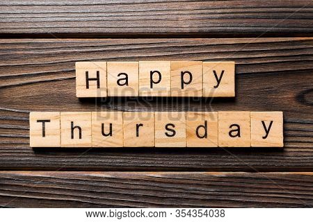 Happy Thursday Word Written On Wood Block. Happy Thursday Text On Wooden Table For Your Desing, Conc