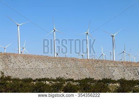 Desert Valley Hill Wind Turbine Farm Blue Sky