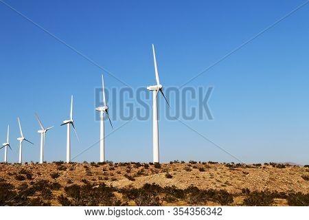 Row Desert Wind Turbines Mountain Blue Sky