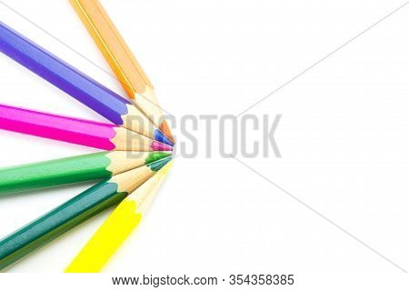 Multicolored Wooden Sharpened Pencils (6 Pieces) Folded In A Semicircle On A White Isolated Backgrou