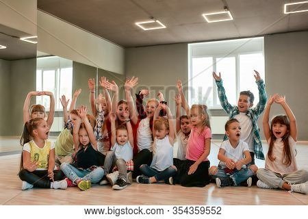 Happy Dancers. Group Of Positive Little Boys And Girls In Fashionable Clothes Posing With Their Youn