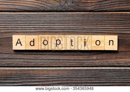 Adoption Word Written On Wood Block. Adoption Text On Table, Concept
