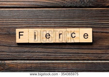 Fierce Word Written On Wood Block. Fierce Text On Wooden Table For Your Desing, Top View Concept