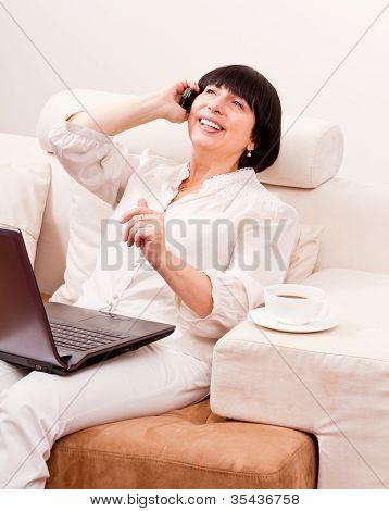 Beautiful Mature Woman Talking On Telephone.