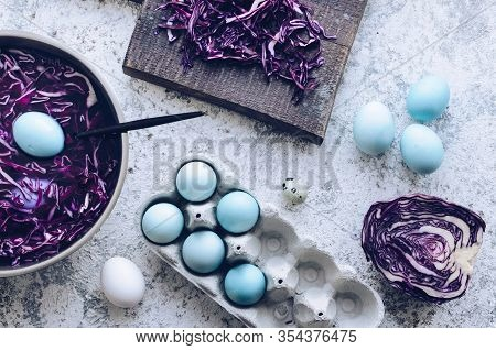 Dyed Blue Easter Eggs Painted With Natural Dye Red Cabbage On Grey Concrete Background. Process Of D
