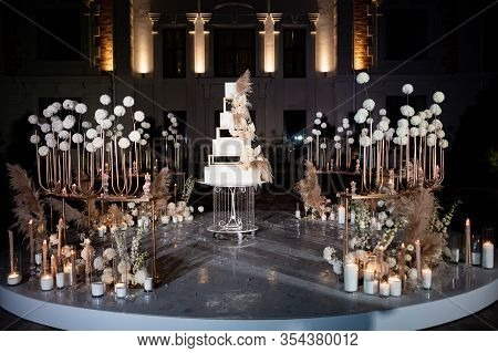 Photo Zone, Unusual White Tiered Wedding Cake. Wedding Decor. A Traditional Treat For The Feast Of T