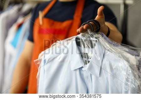 Clothes Dry Cleaning Service Worker Returning Shirts To Customer Close-up