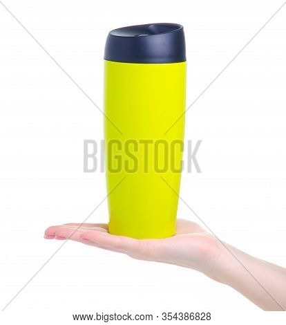 Green Thermos Cup In Hand On White Background Isolation
