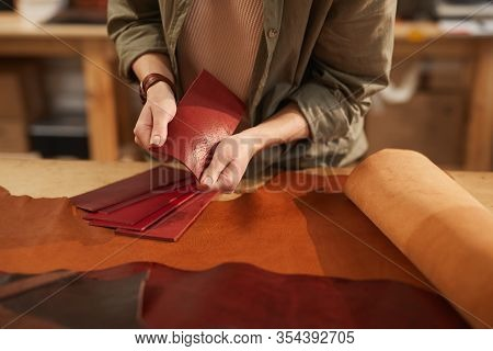 Horizontal Shot Of Unrecognizable Young Woman Choosing Best Leather Material For Her New Craftwork