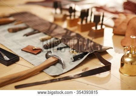 Horizontal High Angle No People Shot Of Various Tools For Professional Leather Craftwork On Wooden T
