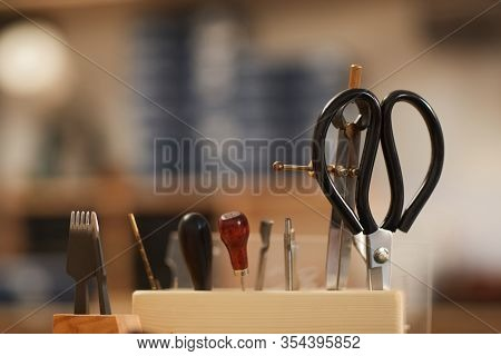 Horizontal Close-up Shot Of Various Craftwork Tools In Holder In Workshop, Copy Space