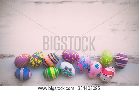 Easter Eggs Painting Decorated On Pastel Wooden Backgrounds With Copy Space For April Easter Day Wit
