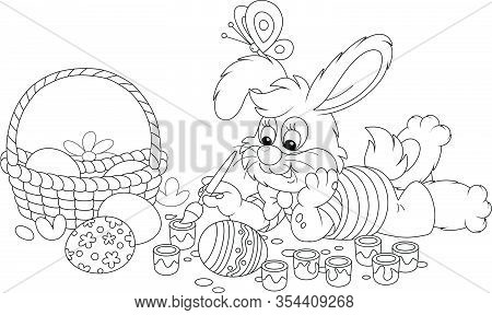 Happy Little Bunny Painting Beautiful Ornate Easter Eggs With Bright And Colorful Paints And An Art
