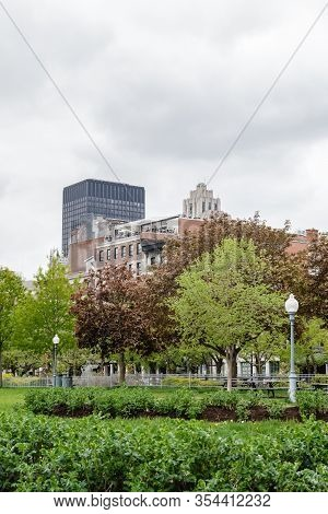 Spring In The Old Port Of Montreal (quebec, Canada). Fresh Leaves, Green Grass, And Modern Buildings