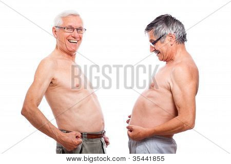 Funny Naked Seniors Comparing Belly